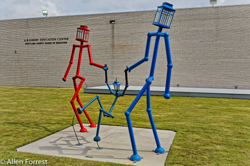 """""""Family Delights"""" by Christian Happle displayed in downtown Laurinburg, North Carolina"""